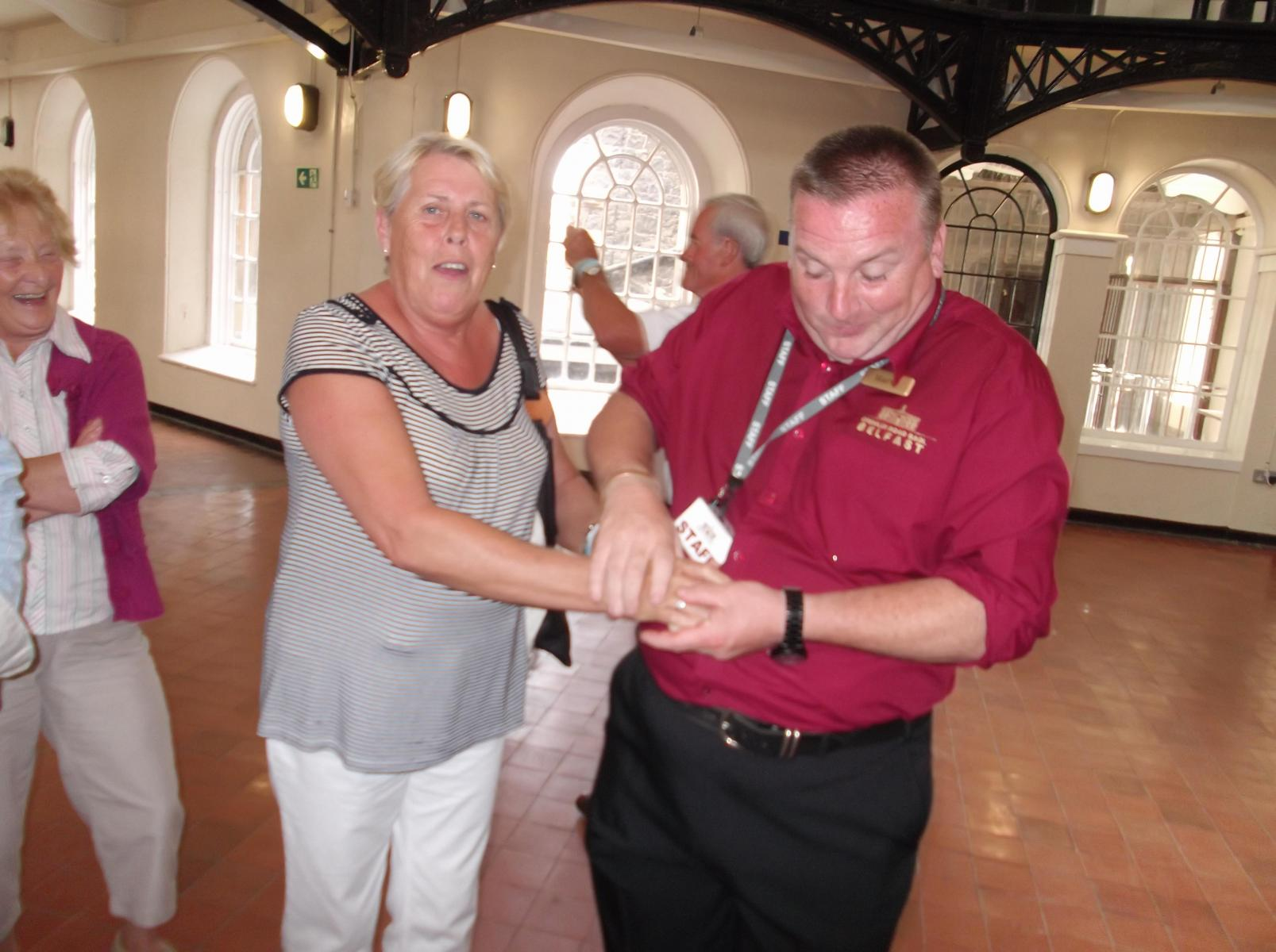 June-being-cuffed-at-the-Gaol-sc